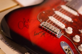 Our Fender guitar signed by Scott, Joe and George